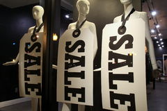 Three mannequins with large SALE signs around their necks Royalty Free Stock Photos