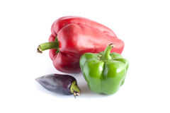 Three many-coloured sweet peppers. On white background Stock Photos