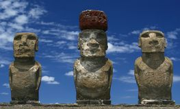 Three Maois. Three maoi statues on Easter island, one with red topknot on head Royalty Free Stock Photos