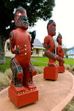 Three maori carvings new zealand Stock Photos