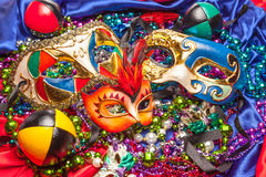 Three Mardi Gras Masks and Beads Royalty Free Stock Image
