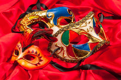 Three Mardi Gras Masks on red silk royalty free stock images