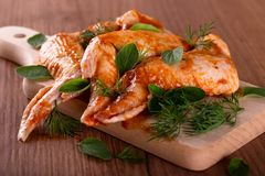 Three marinated chicken wings with herbs Stock Photography