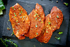 Three Marinated Pork Chops. On a slate plate Stock Images