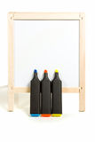 Three markers and whitebord Stock Images