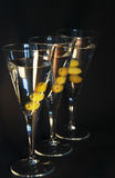 Three martini cocktails. With olives against a dark backdrop Stock Images