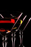 Three martini glasses at the black background. Stock Photos