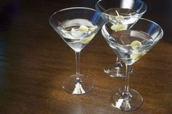 Three Martini Lunch. A three martini lunch on an oak table Stock Photo