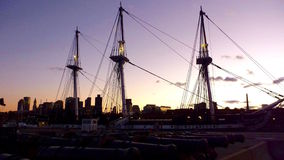 Three mask boat in Boston Harbour at dusk. At the end of The Freedom Trail, or Red Line, this beautiful ship Royalty Free Stock Images