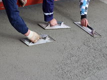 Three mason completed concrete surface Stock Image