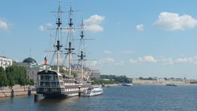 Three-masted frigate near the embankment of the Neva river in the summer Stock Photo