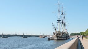 Three-masted frigate near the embankment of the Neva river and the Troitsky Bridge - St Petersburg Stock Images