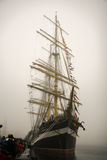 Three-masted Kruzenshtern sailboat. In the fog in the port Stock Image