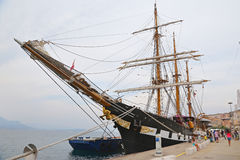 The three masted Palinuro, a historic Italian Navy training barquentine, moored in the Gaeta port. Stock Image