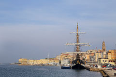 The three masted Palinuro, a historic Italian Navy training barquentine, moored in the Gaeta port. Royalty Free Stock Photo