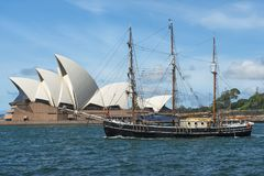 Three-masted sailing yacht and Sydney Opera House in the background Stock Photos