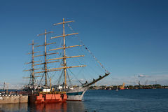 Three-masted schooner moored to the dock Royalty Free Stock Photo
