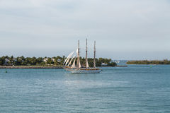 Three Masted Schooner Under Full Sails Stock Photo