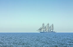 Three masted tall ship in full sails Royalty Free Stock Image