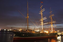Three-master ship in Hamburg port. The sailing Ship Rickmer Rickmers anchoring in Hamburg port at night Stock Image