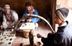 Three masters of cutting marble in Agra, India stock photo
