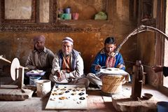Three masters of cutting marble in Agra, India Royalty Free Stock Photo