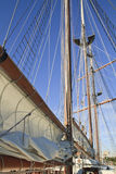 Three Masts, Sails Furled. Masts and furled sails on the booms of a tall ship Stock Image