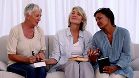 Three mature friends praying together Royalty Free Stock Photos