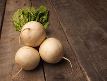 Three may turnip on wood Stock Photography