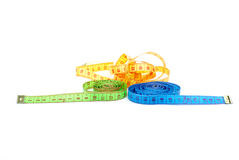 Three measuring tapes of different colors Royalty Free Stock Image
