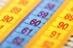 Three measuring tapes showing 90-60-90 as ideal parameters for women. The concept of an ideal figure of a woman.  stock photography