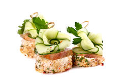 Three meat and cucumber canapes Royalty Free Stock Photography