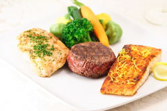 Three meat feast. Assorted meats  a delicious fusion in flavor and presentation fine cuisine Royalty Free Stock Image