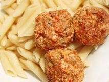 Three meatballs with sauce over pasta Royalty Free Stock Image
