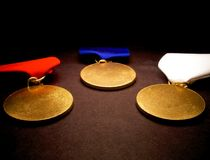 Three Medals. On black royalty free stock images