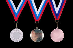Three medals, Gold, Silver and bronze Stock Image
