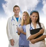 Three medical professionals. Young Asian and caucasian medical professionals standing together Royalty Free Stock Images