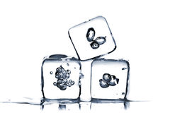 Three melting ice cubes Royalty Free Stock Images