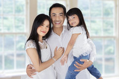Three member of asian family Royalty Free Stock Photos