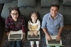 Free Three Member Of Family Working Together Stock Image - 180528701