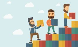 Three men with blocks Stock Images