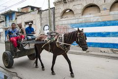 Santiago de Cuba, horse-drawn cart in front of graffiti Royalty Free Stock Photography