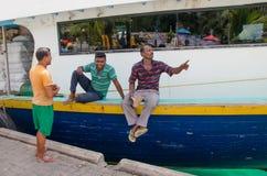 Three men in at docks area Royalty Free Stock Photos