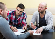 Three men with documents Stock Photography