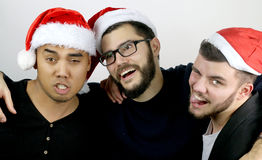Three men drunk at Christmas. On a gray background stock photography
