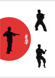 Three men are engaged in karate on a white backgro Stock Images