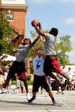 Three Men Fight For Rebound In Outdoor Street Basketball Tournament Stock Image