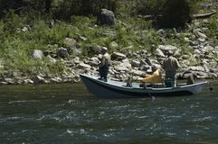 Three Men Fishing. In a Boat stock images