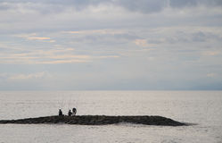 Three men are fishing, Bali Royalty Free Stock Photography