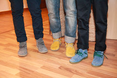 Three men funny and color shoes in legs Stock Photos